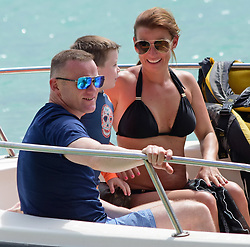 EXCLUSIVE: *NO WEB UNTIL 1345 GMT 22ND MAY* Coleen Rooney in a black bikini and family are spotted on the beach in Barbados. 18 May 2018 Pictured: Wayne and Coleen Rooney. Photo credit: MEGA TheMegaAgency.com +1 888 505 6342