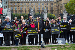 London, October 11 2017. Family members, friends and supporters from Amnesty International attend a protest and vigil in Parliament Square for Nazanin Zaghari-Ratcliffe and Kamal Foroughi, both dual British and Iranian citizens imprisoned in Iran. Zaghari-Ratcliffe was detained in Tehran last year along with her baby daughter Gabriella following a holiday and has been imprisoned on sedition charges. She was told over the weekend that additional charges are being brought against her, carrying an additional 16 years of imprisonment. Foroughi should have been released from prison in January 2014 after serving a third of his sentence.  © Paul Davey