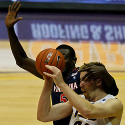 January 2, 2012; Baton Rouge, LA; Virginia Cavaliers center Assane Sene (5) defends LSU Tigers center Justin Hamilton (41) during the second half of a game at the Pete Maravich Assembly Center. Virginia defeated LSU 57-52.  Mandatory Credit: Derick E. Hingle-US PRESSWIRE