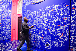 "© Licensed to London News Pictures. 09/06/2019. London, UK. New York based artist Victor Ekpuk puts final details to his hand painting in a new exhibition ""Get Up, Stand Up Now"" at Somerset House, London. The exhibition opens on 12 June and runs until 15 September 2019. Photo credit: Dinendra Haria/LNP"