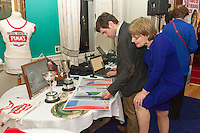 Viewing the table of memoribilia at the reunion night to celebrate 50 years of the Irish Fireball Class, held at the Royal St George YC.