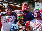 12 MARCH 2017 - BHAKTAPUR, NEPAL:  Nepali men celebrate Holi in Bhaktapur. Holi, a Hindu religious festival, has become popular with non-Hindus in many parts of South Asia, as well as people of other communities outside Asia. The festival signifies the victory of good over evil, the arrival of spring, end of winter, and for many a festive day to meet others. Holi celebrations in Nepal are not as wild as they are in India.    PHOTO BY JACK KURTZ