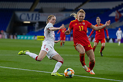 CARDIFF, WALES - Tuesday, April 13, 2021: Denmark's Sara Thrige (L) tackles Wales' Ceri Holland during a Women's International Friendly match between Wales and Denmark at the Cardiff City Stadium. (Pic by David Rawcliffe/Propaganda)