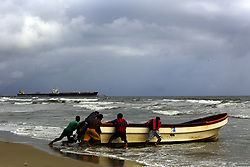 June 20, 2017 - Puerto Cabello, Carabobo, Venezuela - Fishermen try to take their boat to a safe place, before the announcement of the arrival in the next few hours, of the storm Bret. On the beach of El Palito, in Puerto Cabello, Carabobo state. Photo: Juan Carlos Hernandez (Credit Image: © Juan Carlos Hernandez via ZUMA Wire)