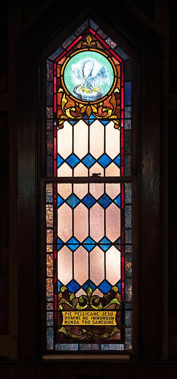 "The inscription, ""Pie pellicane Jesu domine me immundum munda tuo sanguine,"" (Lord Jesus, good pelican, purify me with your blood) is from ""Adoro te devote,"" a hymn by St. Thomas Aquinas.<br /> <br /> Window 6 on plan. 22.5"" x 82"" including sash.<br /> <br /> St. Ignatius of Loyola Catholic Church, Northeast Harbor, Maine."