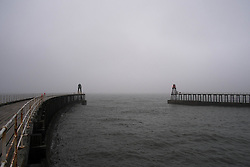 © Licensed to London News Pictures. 03/04/2014<br /> <br /> Whitby, North Yorkshire, United Kingdom<br /> <br /> Heavy fog shrouds the sea outside the harbour entrance in the North Yorkshire seaside town of Whitby. <br /> <br /> Photo credit : Ian Forsyth/LNP