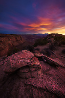 Colorful sunrise light at Shafer Point overlook in Cayonlands National Park, Utah