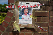Twelve days after the devastating fire that killed an unspecified number of people is the torn poster of a 12 year-old girl called Jessica Urbano, missing from Grenfell tower block which remains a crime scene, on 26th June 2017, in the London borough of Kensington & Chelsea, England.