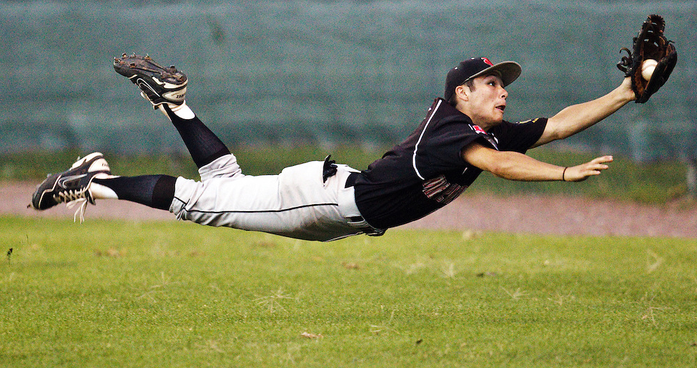 Home Federal right fielder Jordan Ramirez makes a diving catch in foul territory during Saturday's game against Omaha South at Ryder Park in Grand Island.