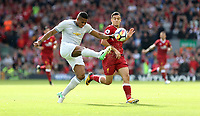 Football - 2017 / 2018 Premier League - Liverpool vs. Manchester United<br /> <br /> Philippe Coutinho of Liverpool and Ashley Young of Manchester United at Anfield.<br /> <br /> COLORSPORT/Joe Perch