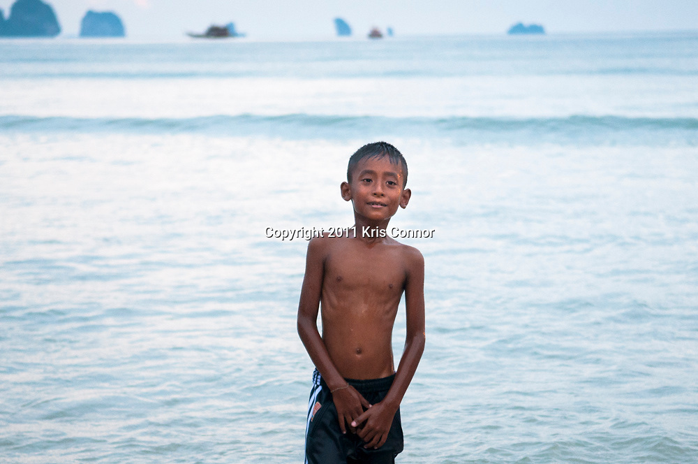 A young boy poses for a portrait in the beach town of Ao Nang, Thailand.