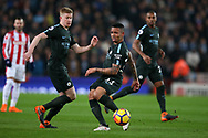 Gabriel Jesus of Manchester City © and Kevin De Bruyne of Manchester City (l) in action . Premier league match, Stoke City v Manchester City at the Bet365 Stadium in Stoke on Trent, Staffs on Monday 12th March 2018.<br /> pic by Andrew Orchard, Andrew Orchard sports photography.