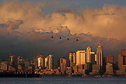 The autumn sun illuminates the Seattle skyline and dramatic clouds above the city. <br /> (Erika Schultz / The Seattle Times)