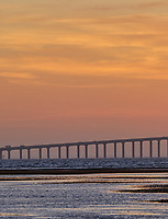 Sun rising under the Sunshine Skyway bridge from Fort De Soto Park. Print copy 1 of 5 images taken with a Fuji X-H1 camera and 200 mm f/2 OIS lens with a 1.4x teleconverter (ISO 400, 280 mm, f/16, 1/80 sec). Raw images processed with Capture One Pro and AutoPano Giga Pro.