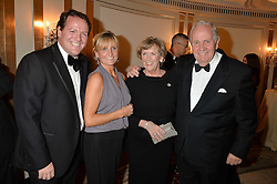Left to right, HENRY HANNON, ? and MR & MRS RICHARD HANNON at the 24th Cartier Racing Awards held at The Dorchester, Park Lane, London on 11th November 2014.