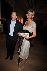 VISCOUNT LINLEY and the COUNTESS OF DERBY at fundraising dinner and auction in aid of Liver Good Life a charity for people with Hepatitis held at Christies, King Street, London on 16th September 2009.