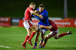 Federico Mori of Italy is tackled by Sam Costelow of Wales <br /> <br /> Photographer Craig Thomas/Replay Images<br /> <br /> U20 Six Nations - Wales v Italy  - Friday 31st January 2020 - Stadiwm Zip World (Parc Eirias) - Colwyn Bay<br /> <br /> World Copyright © Replay Images . All rights reserved. info@replayimages.co.uk - http://replayimages.co.uk