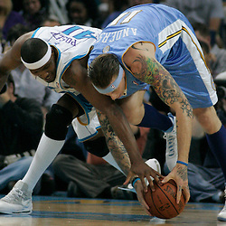 25 March 2009: New Orleans Hornets forward James Posey (41) and Denver Nuggets center Chris Andersen (11) scramble for a loose ball during a NBA game between the New Orleans Hornets and the Denver Nuggets at the New Orleans Arena in New Orleans, Louisiana.