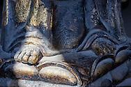 Detail of a Buddha figure in a tibetan temple in the Oscar Film Studios in Ouarzazate, Morocco.