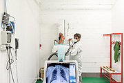 Bergamo, the covid follow up department at Bergamo fair pavilion,rx ray, A patient gets an X-ray at a Bergamo, Italy, convention center that was converted for covid-19 patients in the spring and is now used for follow-up care