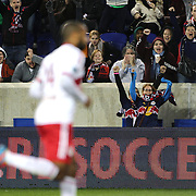 New York Red Bulls fans celebrate as Thierry Henry, New York Red Bulls, runs to the corner flag after scoring his sides third goal during the New York Red Bulls V Houston Dynamo, Major League Soccer regular season match at Red Bull Arena, Harrison, New Jersey. USA. 23rd April 2014. Photo Tim Clayton