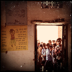 iPhone photo of boys and girls participating in the Pehchan Project in a village outside of Banswara, Rajasthan, India, April 6, 2013. Under Indian law, children younger than 18 cannot marry. Yet in a number of India's states, at least half of all girls are married before they turn 18, according to statistics gathered in 2012 by the United Nations Population Fund (UNFPA). However, young girls in the Indian state of Rajasthan—and even a few boys—are getting some help in combatting child marriage. In villages throughout Tonk, Jaipur and Banswara districts, the Center for Unfolding Learning Potential, or CULP, uses its Pehchan Project to reach out to girls, generally between the ages of 9 and 14, who either left school early or never went at all. The education and confidence-building CULP offers have empowered youngsters to refuse forced marriages in favor of continuing their studies, and the nongovernmental organization has provided them with resources and advocates in their fight.
