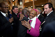 Former archbishop Desmond Tutu is congratulated by colleagues at a ceremony receiving the 2013 Templeton Prize at the Guildhall in London, UK. South African anti-apartheid campaigner Desmond Tutu won the 2013 Templeton Prize worth $1.7 million for helping inspire people around the world by promoting forgiveness and justice.