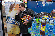 Moscow, Russia, 09/11/2007..Scenes at Pepsi branded kiosks outside Dynamo metro station. Pepsi sales rep Dmitri Kurbanov loads produce into the cooler outside a Pepsi branded kiosk at opening time.