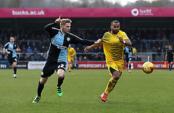Jermaine Easter of Bristol Rovers chases the ball with Jason McCarthy of Wycombe Wanderers - Mandatory byline: Robbie Stephenson/JMP - 27/02/2016 - FOOTBALL - Adams Park - Wycombe, England - Wycombe Wanderers v Bristol Rovers - Sky Bet League Two