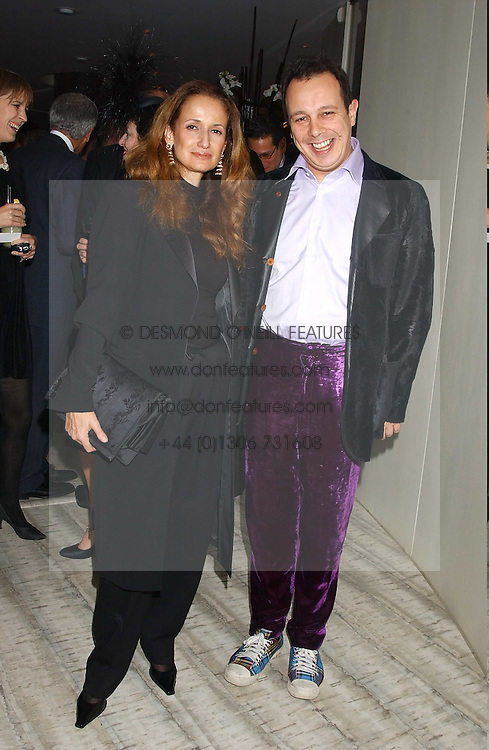 ISABEL GOLDSMITH and DETMAR BLOW at a dinner hosted by Arnaud Bamber MD of Cartier, Amanda Sharp and Matthew Slotover Directors of the Frieze Art Fair to celebrate artists featured in the 2005 Frieze Art Fair Curatorial Programme at Nobu-Berkeley, 15th Berkeley Street, London on 21st October 2005.<br /><br />NON EXCLUSIVE - WORLD RIGHTS