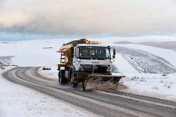 © Licensed to London News Pictures. 14/01/2016. Builth Wells, Powys, Wales, UK. A gritter truck works on the'Brecon Road' between Builth Wells and Brecon. About 5cm of snow fell last night on the high moorland of the Mynydd Epynt, near Builth Wells, Powys, Wales. Photo credit: Graham M. Lawrence/LNP
