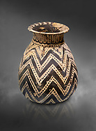 Minoan  alabastron with zig zag design, Machlos 1500-1400 BC; Heraklion Archaeological  Museum, grey background. .<br /> <br /> If you prefer to buy from our ALAMY PHOTO LIBRARY  Collection visit : https://www.alamy.com/portfolio/paul-williams-funkystock/minoan-art-artefacts.html . Type -   Heraklion   - into the LOWER SEARCH WITHIN GALLERY box. Refine search by adding background colour, place, museum etc<br /> <br /> Visit our MINOAN ART PHOTO COLLECTIONS for more photos to download  as wall art prints https://funkystock.photoshelter.com/gallery-collection/Ancient-Minoans-Art-Artefacts-Antiquities-Historic-Places-Pictures-Images-of/C0000ricT2SU_M9w