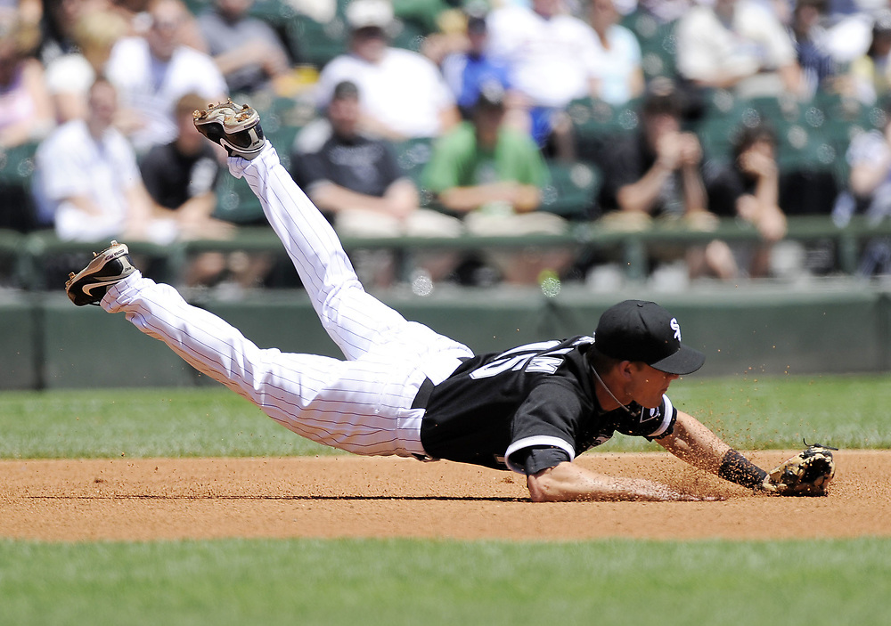 CHICAGO - JUNE 04:  Gordon Beckham #15 of the Chicago White Sox dives but cannot come up with the ball against the Oakland Athletics on June 4, 2009 at U.S. Cellular Field in Chicago, Illinois.  The Athletics defeated the White Sox 7-0.  (Photo by Ron Vesely)