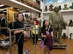 Aug. 09, 2017 - Philadelphia, Pennsylvania, U.S. -  World renowned sculptor ZENOS FRUDAKIS gives a tour of his studio to Allentown (New Jersey) High School seniors EMILY MORSE (tie-dyed shirt) and RACHEL KRIEGER.(Credit Image: © Brian Cahn via ZUMA Wire)