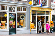 Shoppers and shop front frontage of cheese shop 't Kaaswinkeltje in Lange Tiendeweg Gouda, Holland
