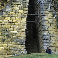 Peruvian archaeologist Dr. Peter Lerche sits below a narrow entrance between the imposing fortress walls at Kuelap, a stronghold of the pre-Incan Chachapoyan culture.