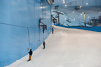 Snowboarding at Ski Dubai, an indoor ski slope in the Mall of the Emirates, Dubai, United Arab Emirates