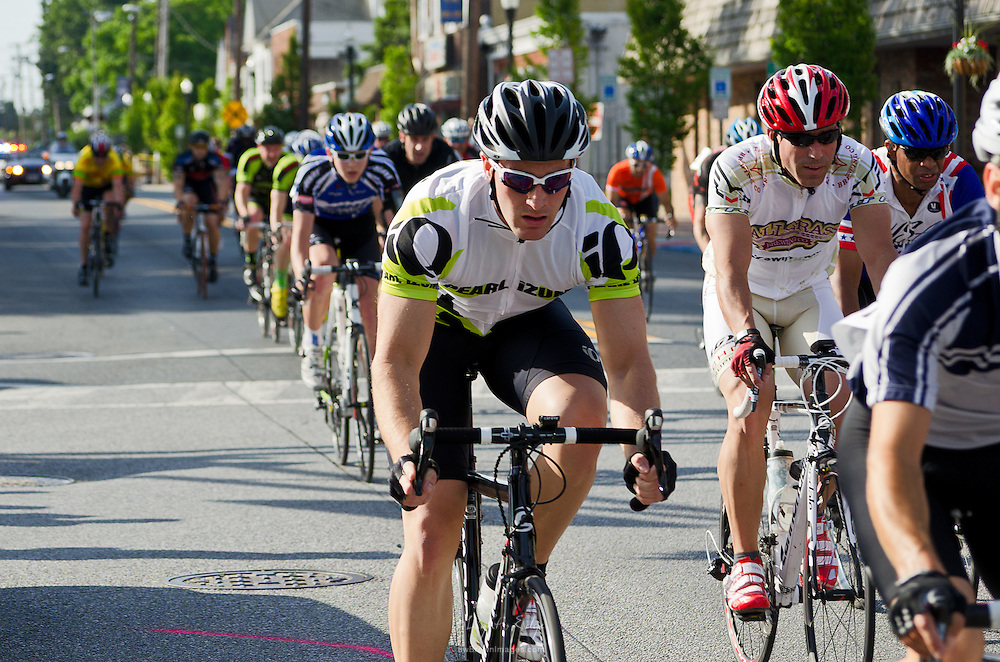 Cyclists ride down Broadway during the 3rd Annual Uptown Pitman Bob Riccio Memorial Race.