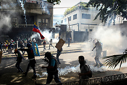 A group of protesters clash with police during a protest by opponents of the Venezuelan government in Caracas, Venezuela, 1 May 2017