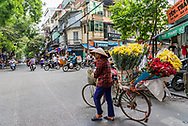 Flower vendor in Hanoi, Vietnam.