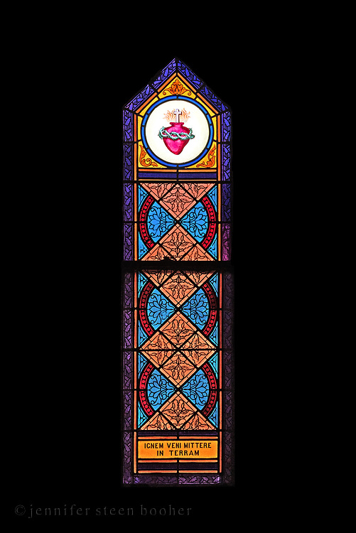 """""""Ignem veni mittere in terram"""" (I have come to bring fire to the earth), Luke 12:49.<br /> <br /> Window 12 on the plan. 22.5"""" x 82"""" including sash."""