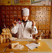 """Chinese apothecaries, like this one in Beijing, still sell ground-up dinosaur bone for pharmaceutical purposes.  """"Stone dragon bones"""" are believed to have the power to cure a variety of ailments."""