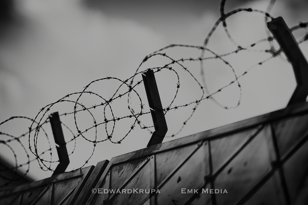 Barbed wire on a prison wall.