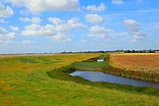 River Ore salt marsh coastal flood defence bank and footpath, Boyton, Suffolk, England, UK