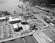 Ackroyd 19336-20 NW Marine Iron Works. Aerials. Pac barge progress. Keel laying. May 28, 1975