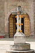 Stone cross at the Templo de San Pedro Cucuchucho or Saint Peter Church in Cucuchucho, Michoacan, Mexico.