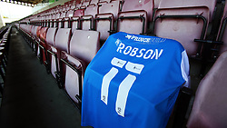 A Peterborough United shirt showing the name 'Robson 11' is placed in the away end at the PTS Academy Stadium in tribute of Peterborough United record appearance holders Tommy Robson, who sadly passed away this week. - Mandatory by-line: Joe Dent/JMP - 10/10/2020 - FOOTBALL - PTS Academy Stadium - Northampton, England - Northampton Town v Peterborough United - Sky Bet League One