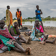 Community members wait for a distribution of non-food items, following devestating flooding, in Pibor, Boma State, South Sudan, on 6 November 2019 // Photo credit: UNICEF South Sudan/de la Guardia