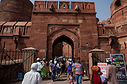 Tourists are entering the main gate to the Agra Fort.