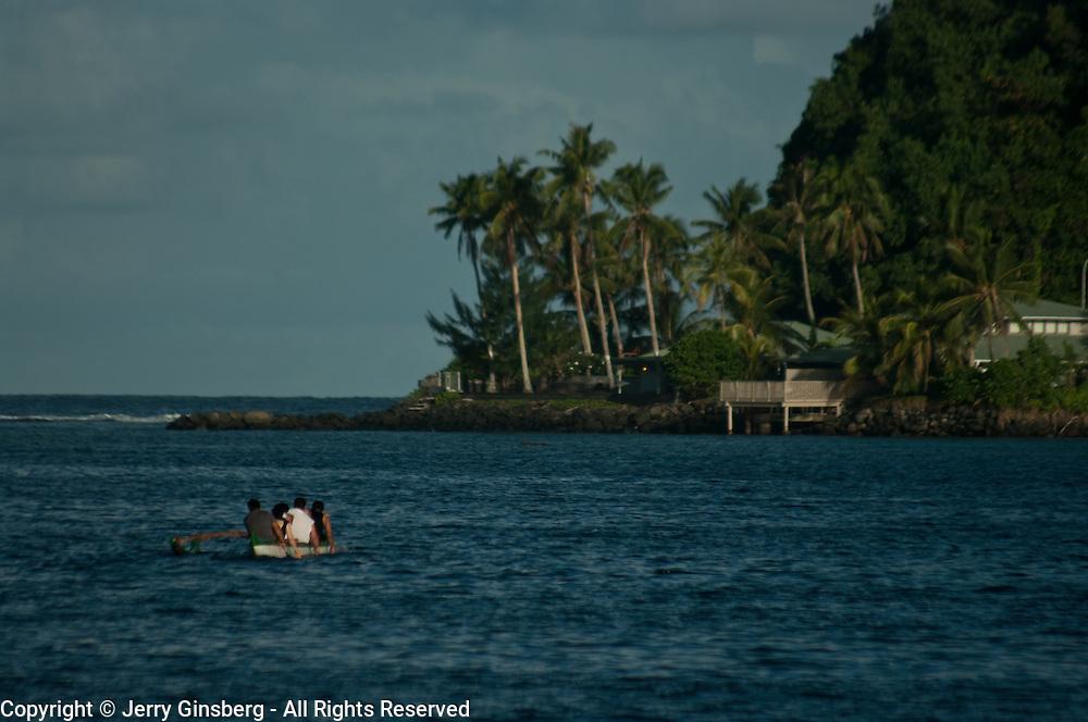 Paddling an outrigger canoe in Pago Pago, Tutuila, American Samoa.
